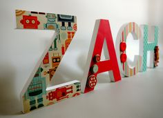 Custom made, hand made, personalized wooden letters - Decorated in ROBOT theme. Stand alone or hang on wall of children's room or nursery.. $15.00, via Etsy.