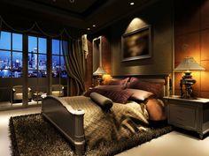Luxuriös eingerichtete Schlafzimmer mit Holz getäfelte Wand, große dunkle Holzmöbel, stilvolle Teppich und Balkon