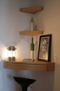 floating corner shelves - love the bottom corner pull out drawer! Great way to store lotions and tools