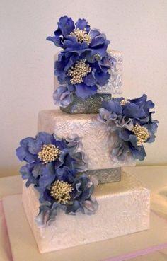 Blue Fantasy Flowers adorn this lovely Ivory Wedding Cake Beautiful Wedding Cakes, Gorgeous Cakes, Amazing Cakes, Wedding Cakes With Cupcakes, Cupcake Cakes, Mod Wedding, Ivory Wedding, Purple Wedding, Floral Wedding