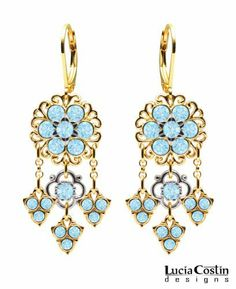 24K Yellow Gold over .925 Sterling Silver Chandelier Flower Earrings Designed by Lucia Costin with Filigree Elements and Fancy Flowers, Adorned with 3 Cute Charms and Light Blue Swarovski Crystals Lucia Costin. $78.00. Splendid combination of dangle elements. Splendid chandelier earrings by Lucia Costin. Unique jewelry handmade in USA. Amazingly studded with aquamarine Swarovski crystals. Update your everyday style with inspiration when wearing this piece of jewelry