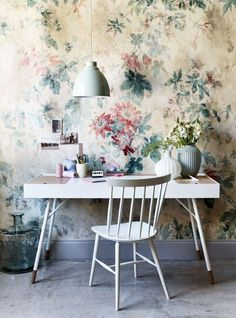 Contrast a fabulous aged-effect floral wallpaper with sleek, modern furniture. Using an understated colour palette allows the wall design to stand out. Find more room ideas at housebeautiful.co.uk
