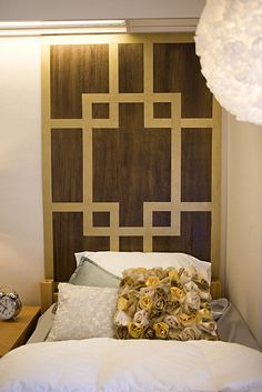 Headboard made from stained plywood and painters tape spray painted gold (could also use decorative duct tape).