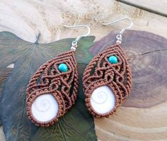 Gorgeous micro macrame earrings with two Shiva Eye Shell and natural Turquoise beads set in brown wax thread.