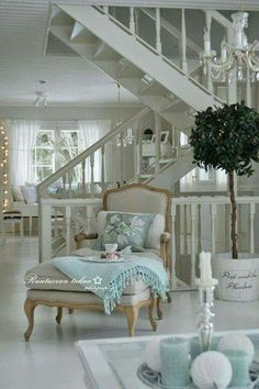 love the colors and the natural light. So airy and comfortable with a touch of elegance.