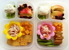 Turkey slices, crackers and cheese, snap peas, apple slices, Craisins and Hello Kitty Egg