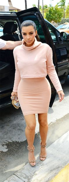 Vogue.com — Kim Kardashian in Azzedine Alaïa dress and shoes, Kardashian Kollection top, and a Dolce & Gabbana bag