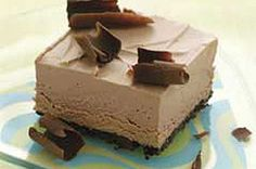 Frozen Chocolate Mousse Squares recipe -                   Chocolate on chocolate, topped with chocolate. Sound stupendous? It is, from the OREO Cookie crust to the whipped center to the chocolate curls on top. #NoBakeDesserts