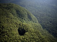 ♻ A gaping cave opening makes a tract of Malaysian rain forest look like it's opening its monstrous mouth. The cave, located on the island of Borneo, is in the Danum Valley Conservation Area. This protected area covers 169 square miles (438 square kilometers) of lowland forest, home to ten primate species and more than 110 other mammal species.          [Image Credit: Mattias Klum I National Geographic, © 2012 I Location: Borneo, Malaysia]