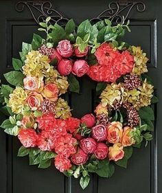 In an unreserved expression of cheer, bold rose and poppy blooms gather amid ball hydrangea and lemon leaf greenery. The lifelike foliage is exquisitely detailed and arranged to create an enduring accent with depth and dimension. Poppy Wreath, Floral Wreath, Lemon Leaves, Grand Entrance, Grapevine Wreath, Grape Vines, Hydrangea, Greenery, Orchids