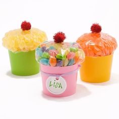Candy-Filled Cupcakes Turn a regular bag of candy into a cupcake look-alike. Fill a sandwich bag with candy and close tightly. Place the bag with the closing down in a colored plastic cup. Top off with a red crafts pom-pom ?cherry.? by dominique