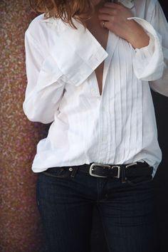 crisp white shirt and dark jeans