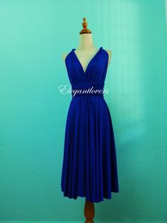I like this!!  Etsy listing at https://www.etsy.com/listing/187265598/cobalt-blue-knee-length-wedding-dress