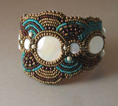 This is my Southwestern Beaded Cuff.  It is done using bead-embroidery techniques and back in sueded leather.