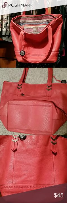 The Sak Leather Tote Large, two handle, leather tote in coral salmon color. Perfect shade between burnt orange and salmon pink. Soft leather. Stitch detail at bottom, gun metal hardwear detail. Perfect lining.  A few small pen marks visible in 3rd photo zoom. Slight wearing on bottom of bag. Large and roomy. Appx 12Lx17wx6D. 9 inch handle drop. Zipper compartment on outside.1 zipper and 2 notch pockets on inside. High quality bag from The Sak. The Sak Bags Totes