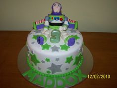 This is an cake, covered and decorated in mmf with a handmade fondant Buzz Lightyear on . Toy Story Birthday, Toy Story Party, 8 Inch Cake, Buzz Lightyear, Birthday Parties, Birthday Cakes, Cakes And More, Let Them Eat Cake, Fondant