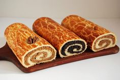 Bejgli (alternatively spelled Beigli) is a delicious Hungarian Christmas treat. This pastry is ubiquitous around Christmas time, you can buy it in practically any shop or bakery. Both walnut (diós) . Hungarian Desserts, Hungarian Cake, Hungarian Cuisine, Hungarian Recipes, Hungarian Food, Xmas Food, Christmas Desserts, Christmas Treats, Hungarian Nut Roll Recipe