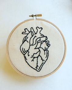 This hand stitched anatomical heart hoop art has been hand drawn and then carefully hand stitched using top quality black threads. This eye Embroidery Hearts, Embroidery Monogram, Embroidery Hoop Art, Hand Embroidery Designs, Cross Stitch Embroidery, Embroidery Patterns, Machine Embroidery, Etsy Embroidery, Anatomical Heart