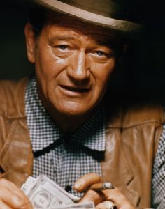 John Wayne Photo Gallery: John Wayne starred in the 1961 western 'The Comancheros', and directed the remainder of the film when director Michael Curtiz took ill. (Photo:  CinemaPhoto/CORBIS)