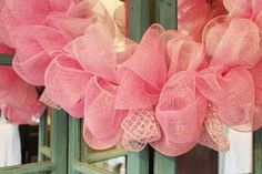 Recently, I saw a deco mesh wreath that had the mesh   attached in such a fun and fluffy way that I inspected it to see   how it was d...