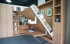 China Hotel Use Space Saving Folding Wall Bed Modern With Bookshelf And Office Table supplier