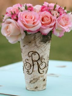 """Birch bark wood vase with a waterproof tin lining that measures 9"""" tall, opening measures 4-3/4"""" wide, & base measures 2-3/4"""" wide. Each vase is personalized with an initial or 3 letter monogram in fancy swirl cursive or standard font."""