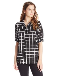 Calvin Klein Women's Windowpane Roll Sleeve Top, Black/Birch, X-Small. Button-front blouse in windowpane plaid featuring long convertible sleeves with button-tab keepers.