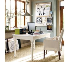 Small Sky Blue and White Color Paint Decorating an Office at Home with Minimalist White Wood Office Desk that have Countertop Accessories and Rustic Style White Chair on the White Wood Flooring also Barn Style Metal Chrome Pendant Lamp complete with the Picture Frames Wall Accessories