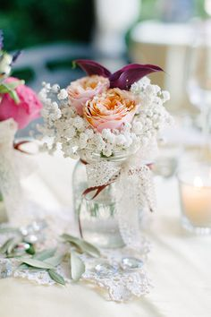 Romantic Portovenere Italy Destination Wedding, Centerpiece with Baby's Breath and Roses | Brides.com