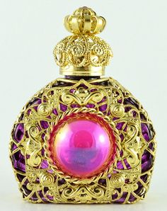 Gold tone filigree pink glass stone perfume bottle