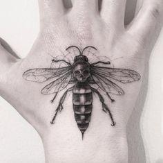 Bee tattoo on hand by Sanghyuk Ko