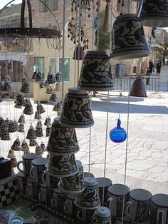 hand painted pottery bells, Hebron, West Bank. I have candle sticks in this pattern from the souk in the Old City of Jerusalem. Very pretty.