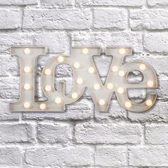 Add some character to your home with these quirky LED wall lights. Ideal for both kids and adults, these lights will add character to a lounge, bedroom or playroom.   Mount on the wall or display on a sideboard or mantle piece, these fun lights are suitable for all settings.   Powered by AA batteries and made of plastic, these wall lights are easy to clean and the long lasting LED bulbs mean you don't have to worry about the bulbs going!   Available in white or black, and also available i...
