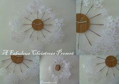 Laminated paper snow flake clock ornament