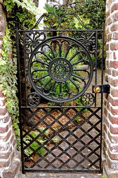 [I love these gates that invite you to come look in. When we visit Charleston, we must be sure to allow plenty of time there.] Garden Gate in Charleston, SC Garden Gates And Fencing, Garden Doors, Fence Gate, Charleston Sc, Charleston Gardens, Metal Gates, Wrought Iron Fences, Tor Design, Gate Design