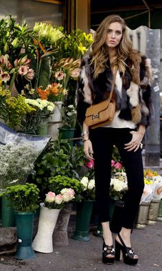 The blonde Salad/ Chiara Ferragni/  ERIKA CAVALLINI SANDALS GOLDSIGN BLACK JEANS MSGM FUR COAT HERMES CONSTANCE BAG
