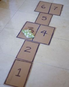 Lesson plan to teach number recognition and counting with indoor hopscotch. Make it into a robot.