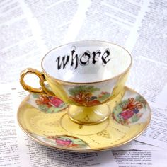 Whore teacup and saucer in yellow by geekdetails on Etsy, $35.00