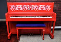 This was one of my favorite pianos I did for My First Piano. It took three layers of fire engine red spray paint to get perfecty even (A lot of work.) I modeled it after Elton John's Red piano (which was a yamaha) and added a pearlescent, interference paint, stencil on the music deck. It was my favorite but was a little outside of the customer base's comfort zone. Alas.