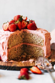 This strawberry cake gets its flavor from fresh strawberries! It's soft and moist, with a flavorful strawberry cream cheese frosting. It's so easy to make and tastes way better than any strawberry box mix. #strawberrycake #strawberries #cake #butternutbakery | butternutbakeryblog.com