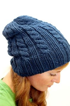 This listing is for a KNITTING PATTERN. Elizabeth is a cozy cabled hat that can be worn slouchy or with the brim rolled up. Knits up quickly is bulky yarn, perfect for gift knitting. This pattern is an excellent introduction to cable knitting. YARN 137yds/125m of Bulky Yarn, (shown in