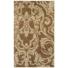 This brown and taupe patterned area rug will ground your space with a touch of class.