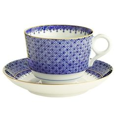 """Blue Lace Cup and Saucer by Mottahedeh The Blue Lace Cream Soup and Saucer is an elegant little tea cup you will want to use everyday. Decorated with a versatile pattern with a delicate teardrop border in blue, inspired by the Ch'ing Dynasty (1644-1911), this tea cup and matching saucer is gorgeous in its cobalt blue and accents of 22 karat gold. Coordinates with other Mottahedeh services. This charming tea cup is favorite among brides at Sallie Home. Dimensions: 3.5"""""""" Dia, 2.75"""""""" H"""