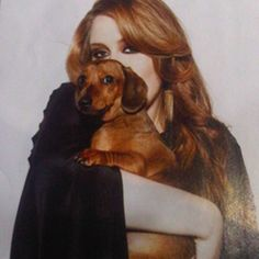 As if her voice isn't enough, Adele is also a doxie lover! Here with her boy Louie!