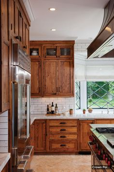 wood cabinets and marble