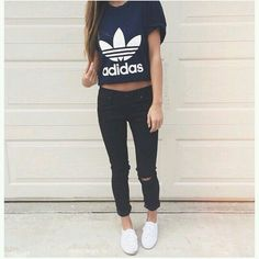 Dark blue Adidas shirt , black knee ripped jeans , white vans