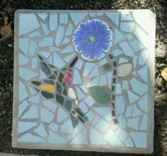 MOSAIC: My first mosiac tile stepping stone of hummingbird and flower. By Kristi Stowell Cole
