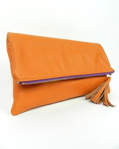 K.slademade tangerine foldover clutch as seen on The Pioneer Woman's site today. Gorgeous! $72