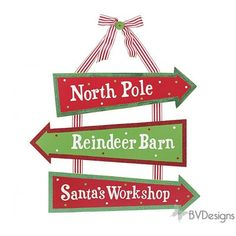Hand painted wooden signs with arrows for North Pole, Reindeer Barn, and Santa's Workshop hanging from red and white grosgrain ribbon. Exclusively brought to you by BVDesigns.