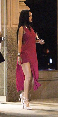 Rihanna flashes her long legs in sexy fuchsia gown in New York